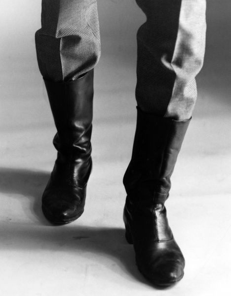 The boots someone is wearing. Date: late 1960s