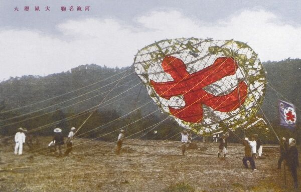 Launching a huge Japanese kite on a festival day, Japan. Date: circa 1910s