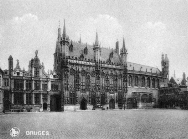 View (from left to right) of the Law Courts, the City Hall and the Basilica of St Sang (Sacred Blood) (Heilig-Bloedbasillek), from across a cobblestone square in Bruges (Brugge), Belgium. Date: circa 1920