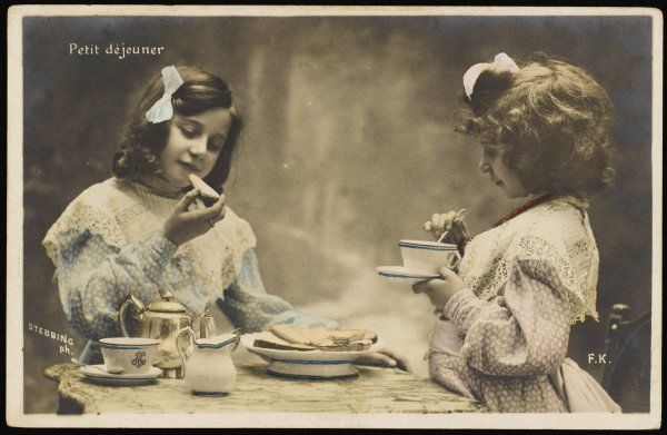 LE PETIT DEJEUNER Two little French girls start the day with coffee and toast (1 of 2)