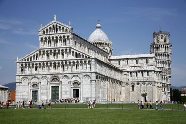 The Leaning Tower of Pisa and the Duomo Cathedral of Santa Maria Asunta in the Piazza del Duomo, the Square of Miracles, in Pisa, Italy