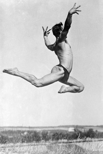 A jumping German athlete striking a pose in mid air. Date: early 1930s
