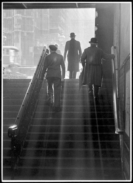 'Way Out' - commuters walking up the steep steps leading out of Westminster underground station, central London, England