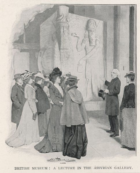A lecture in the Assyrian Gallery of the British Museum. The speaker points towards one of the massive carved Lion supports removed by Layard from excavations at Nineveh