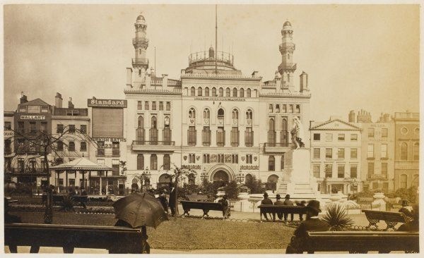 Leicester Square in 1877 is still dominated by the flamboyant Alhambra Theatre