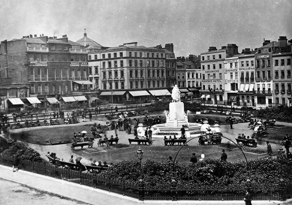 Photograph showing the gardens and surrounding buildings of Leicester Square, London, c.1880