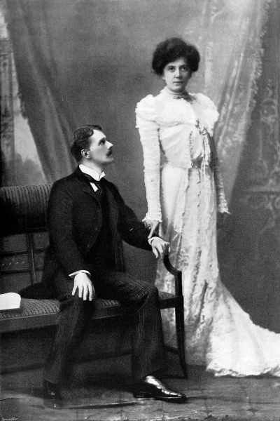 Photograph showing Lena Ashwell as 'Lady Curtoys' and Mr. T.B. Thalberg as 'Egerton Vartrey' in the play 'Wheels within Wheels' at the Court Theatre, London, 1899
