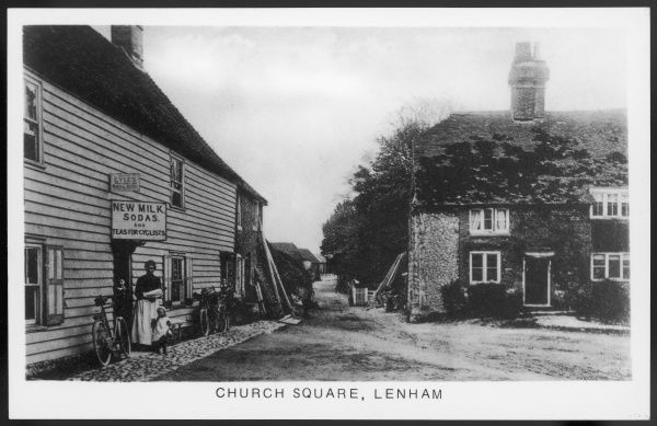 LENHAM, KENT, ENGLAND. Church Square. Brick and weatherboard cottages, including a small shop selling teas and 'new milk sodas' for cyclists