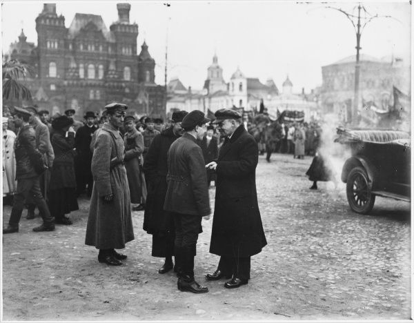 VLADIMIR LENIN Russian statesman, talking to men in Red Square, Moscow, Russia, while his car waits for him