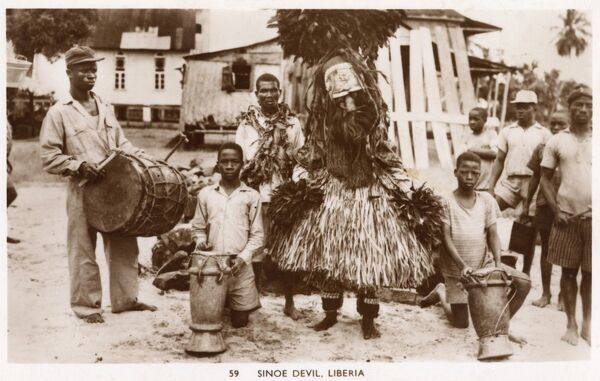 Liberia, West Africa - a 'Sinoe Devil' - a man in the ceremonial costume of the devil from the Sinoe Region of the country. Date: circa 1910s