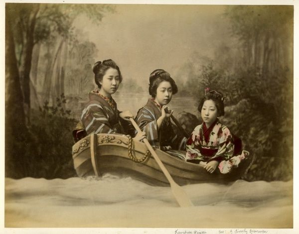 Three Japanese women in a rowing boat
