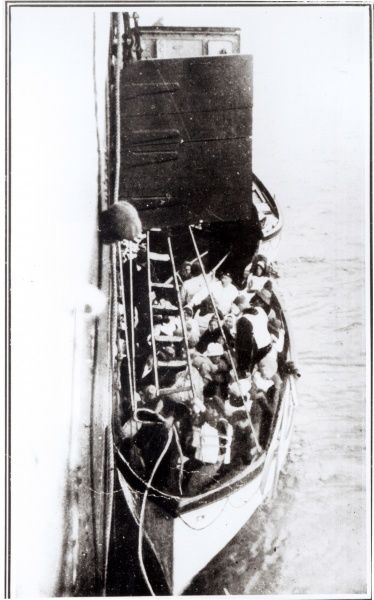 A photograph showing a rope ladder being fixed from the lifeboat to the Carpathia