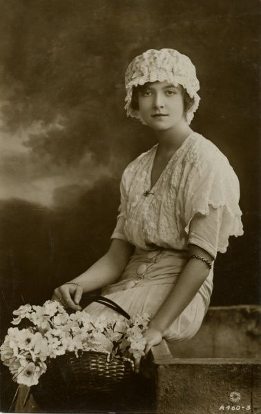Lillian Hall-Davies (1898-1933), British film actress of the silent era. She failed to make the transition to talkies, and committed suicide. Seen here in a mob cap, holding a basket of flowers.  early 20th century