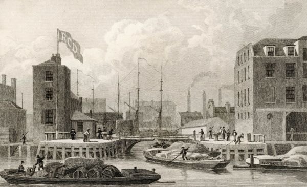 Limehouse Docks, at the entrance to the Regent's Canal. Cargoes are transferred from the sea-going vessels to barges for transport on the canal