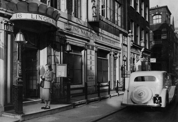London street scene featuring the Ling Nam Chinese Restaurant. circa 1940s
