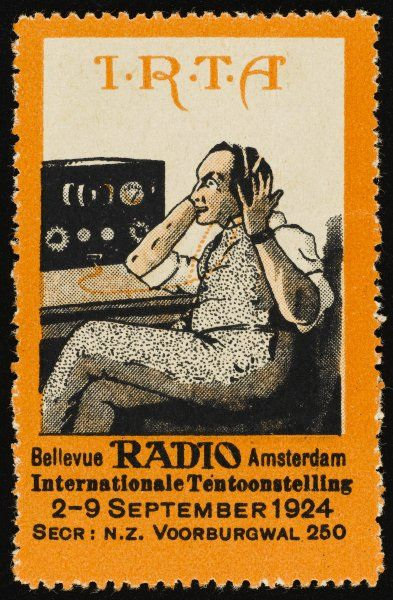 A Dutch listener listens to the radio through headphones