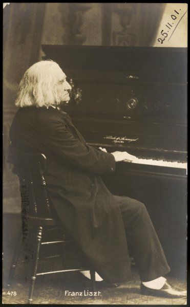 FRANZ LISZT in old age, at the keyboard