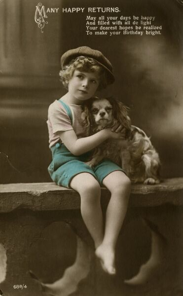 A little boy with a King Charles spaniel on a birthday postcard. (2 of 2) Date: early 20th century