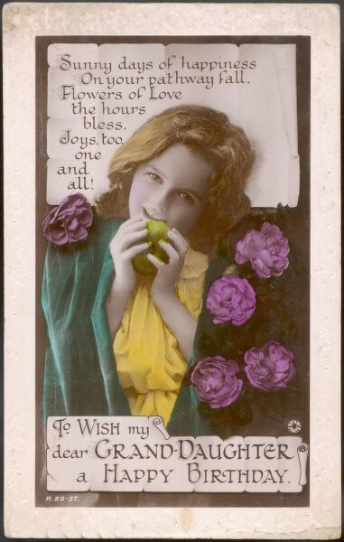 A little girl with flowers and an apple, on a greetings postcard to wish my dear grand-daughter a Happy Birthday.  circa 1910s