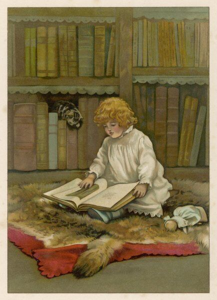 'The little librarian' A girl sits on a fur rug, with her doll and a cat for company, and chooses a large book from the shelf to read