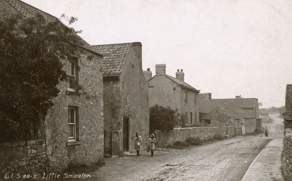 View of the village of Little Smeaton, near Pontefract, Yorkshire, with two little girls carrying milk in pails. Date: circa 1900