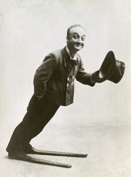 "LITTLE TICH (Harry Relph) Music hall entertainer (1867 - 1928), posed in his famous 28"" boots called slapshoes, for his Big Boot dance. Date: c.1905"