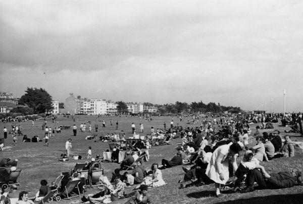Sunbathing on deckchairs and enjoying the good summer weather at Littlehampton Common, West Sussex, England. Date: 1950s