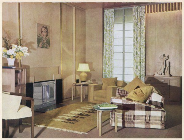 A living room decorated in neutral tones designed by T.Hayes Marshall