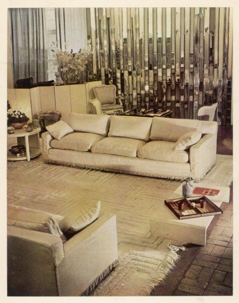 An all white living room in the Chelsea home of Syrie Maugham