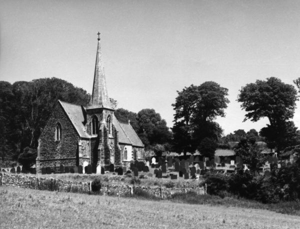 The little church in the village with the longest name, which is usually abbreviated to 'Llanfair P.G.', on the Isle of Anglesey, Wales. Date: 1960s photo