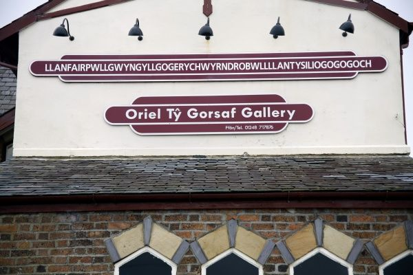Llanfairpwllgwyngyllgogerychwyrndrobwllllantysiliogogogoch station sign, Wales, Britain, the town with the longest place name also known as Llanfairpwll circa 2008
