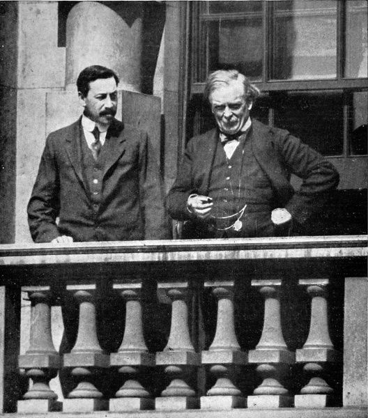 The Liberal politicians David Lloyd George (1863-1945) and Herbert Samuel (1870-1963) watching a passing parade