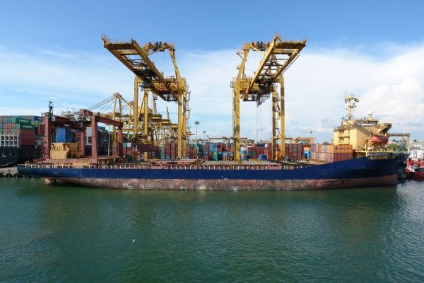 Loading containers at the busy port of Colombo, Sri Lanka