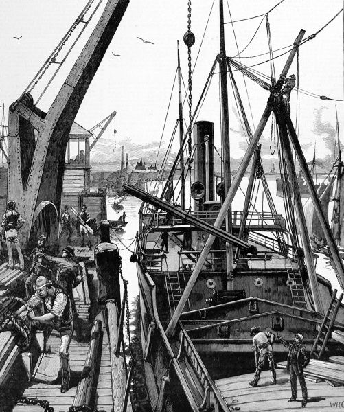 Engraving showing the loading of rails and other materials for the Souakim Railway onto a steamship, at Woolwich, 1884. Stevedores and dockworkers are visible, preparing the load for the ship and supervising its transfer to the ship's hold