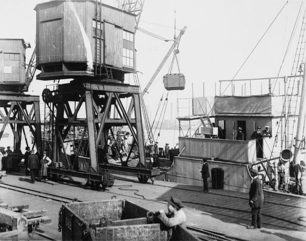 Loading a supply ship at the docks for transport overseas during World War I