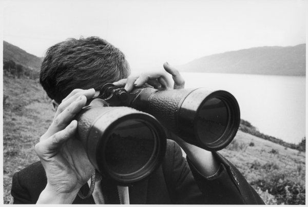 Watching for the Loch Ness monster through a pair of binoculars