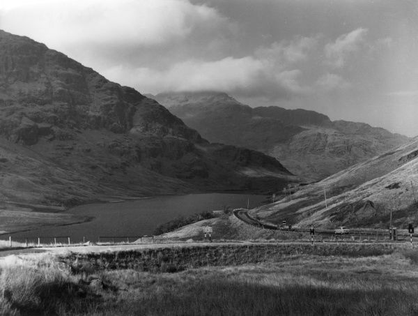 A fine impression of Loch Restal, at the summit of Rest and Be Thankful, a famous road between Arrocher and Inverary, Scotland. Date: 1950s