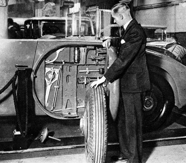 An ingeniously constructed side locker for carrying tools inside a spare wheel space; a new fitting in the 40-50h.p. Rolls Royce with Barker body