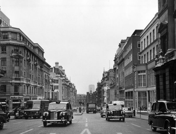 Lots of the famous 'Black Cabs' on St. James's Street, central London. Date: late 1960s