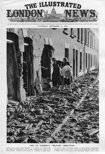 Residents from the bomb damaged street, peer through a huge whole in their house, viewing the utter destruction caused by Goering's men, and salvaging clothes and blankets from the ruins. Date: September 1940