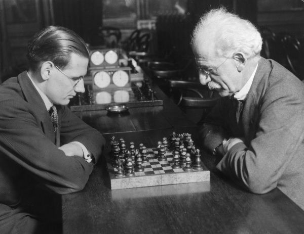 Members of the City of London Chess Club playing a new game of chess, invented by Polish composer Ludomir Michal Rogowski. 81 (not 64) pieces and even a 'Dictator' piece! Date: 3 October 1932