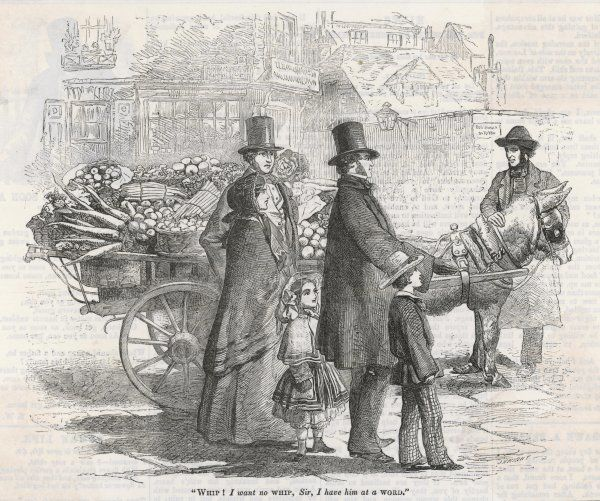 A London costermonger with a fully laden cartload of vegetables