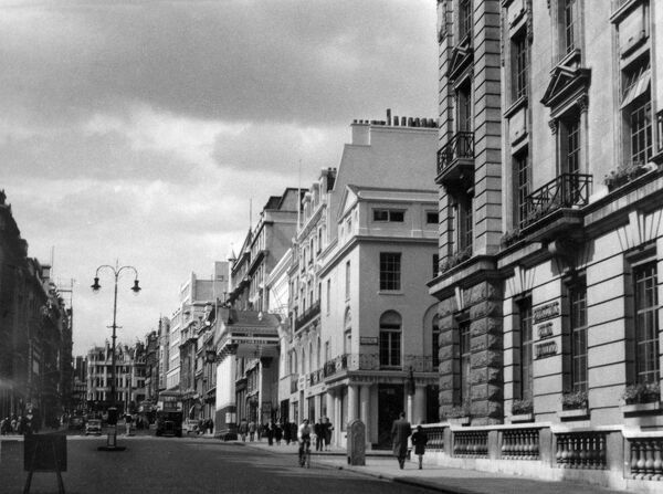 A busy scene on Haymarket, central London, viewed from Pall Mall. Date: 1950s