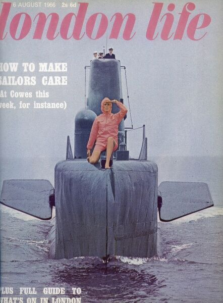 Front cover of London Life magazine, the short-lived magazine which captured swinging sixties London, featuring a model wearing orange shorts and hooded jacket bravely sitting on the prow of HMS Token, a Royal Navy submarine
