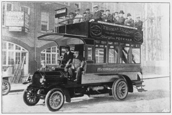 A motor bus in London. All the occupants have decided to sit in the exposed upper deck