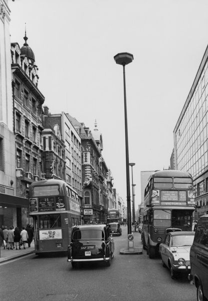 Oxford Street London, looking east, showing two No. 25 Routemaster buses, one going east to Aldgate, the other going west to Victoria. Date: mid 1960s