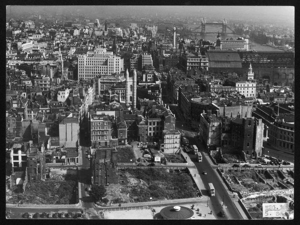 London, looking east towards Monument and Tower Bridge, from the top of St. Paul's Cathedral. Note the bomb sites still in evidence after the World War Two blitz