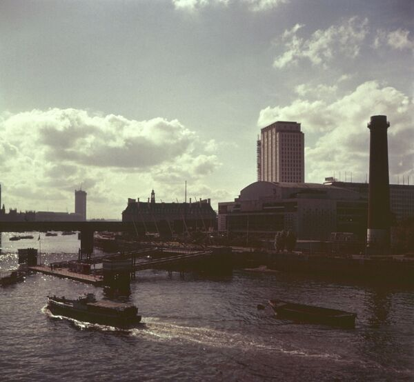 View across the Thames showing the Festival Hall, with the old Shot Tower (since demolished) on the right. Date: 1960s