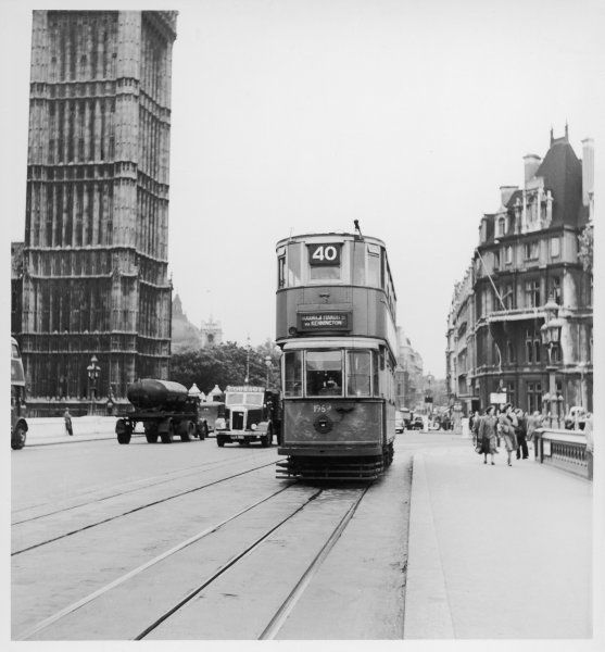 A No. 40 electric tram passing by the Houses of Parliament, Westminster, London, before crossing Westminster Bridge, destination Woolwich, via Kennington. Date: 1930s