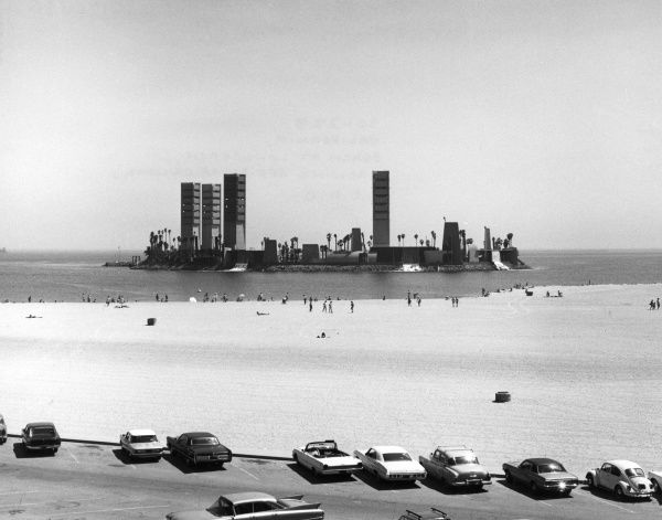A beach at Longbeach, showing offshore drilling, California, U.S.A. Date: late 1960s